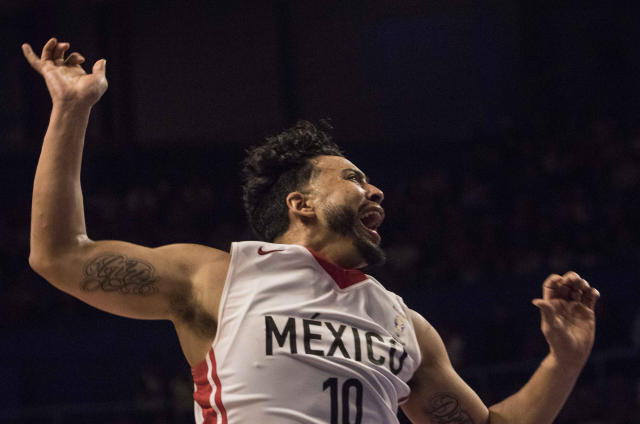 Mexico's Gabriel Giron celebrates his point against the U.S. during the third quarter of a regular season FIBA basketball World Cup qualifier in Mexico City, Thursday, June 28, 2018. (AP Photo/Christian Palma)
