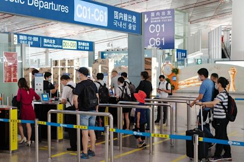 Travellers making their way to the domestic departures area at Beijing Capital International Airport on Tuesday, August 25, 2020. Photo: Bloomberg