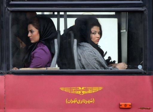 Iranian women sit on a bus in Tehran. Iran has inflation of over 20 percent, an estimated unemployment rate of 12-25 percent, a currency severely weakened in the past four months, and Western economic sanctions imposed to curb Tehran's disputed nuclear programme