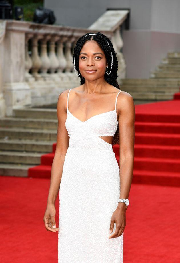 Naomie Harris in an ethereal gown with side cutouts and major ear jewelry. (Photo: Gareth Cattermole via Getty Images)