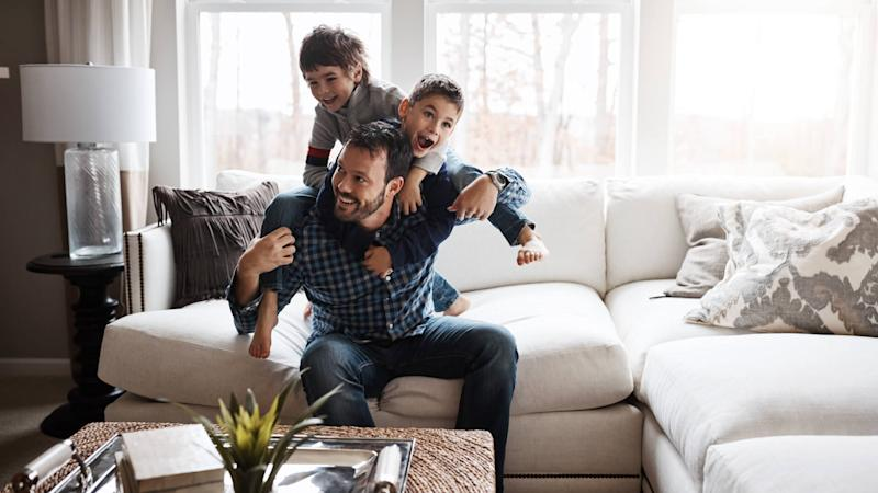 father with two sons at home