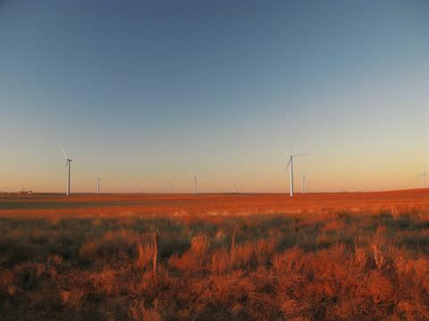 GE is providing capital and technology for a wind farm under construction in Kansas that will harnes ...