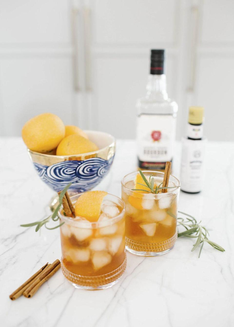 "<p>""This cinnamon-rosemary-bourbon old fashioned with homemade simple syrup is a delicate balance of sweet and tangy and makes the perfect libation for those crisp winter happy hours. Honey, rosemary, cinnamon, and orange are just a few of the warm flavors you'll find in this cocktail, creating a killer combination with a definite punch of bourbon."" -<a href=""https://www.graymalin.com/"" rel=""nofollow noopener"" target=""_blank"" data-ylk=""slk:Gray Malin"" class=""link rapid-noclick-resp"">Gray Malin</a>, fine art photographer</p><p>Get Gray's recipe for this holiday sip <a href=""https://www.graymalin.com/lifestyle/cinnamon-rosemary-bourbon-old-fashioned"" rel=""nofollow noopener"" target=""_blank"" data-ylk=""slk:here"" class=""link rapid-noclick-resp"">here</a>.</p>"