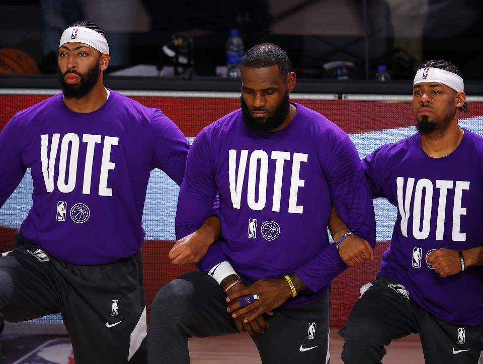 LeBron James (center) has gone above and beyond as a humanitarian and athlete. (Photo by Mike Ehrmann/Getty Images)
