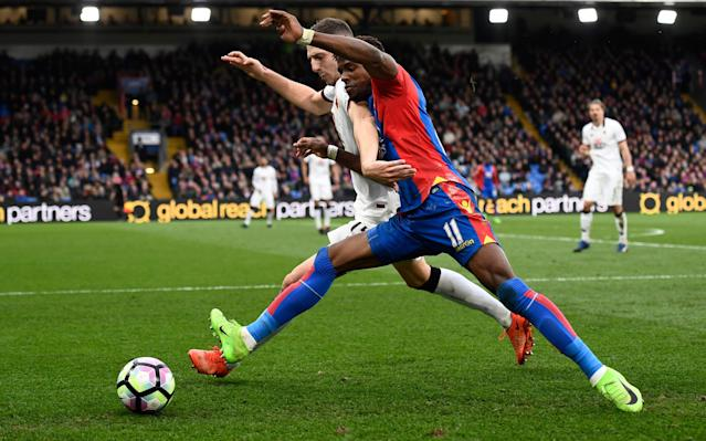 <span>Wilfried Zaha tussles for the ball with Craig Cathcart</span> <span>Credit: REUTERS </span>