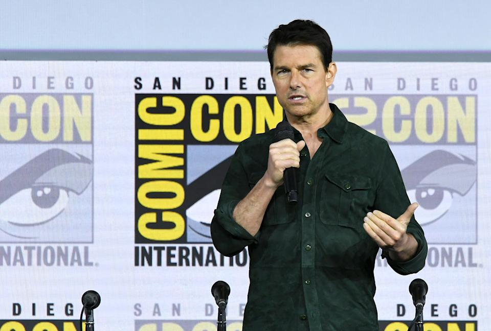 """SAN DIEGO, CALIFORNIA - JULY 18: Tom Cruise makes a surprise appearance to discuss """"Top Gun: Maverick"""" during 2019 Comic-Con International at San Diego Convention Center on July 18, 2019 in San Diego, California. (Photo by Kevin Winter/Getty Images)"""