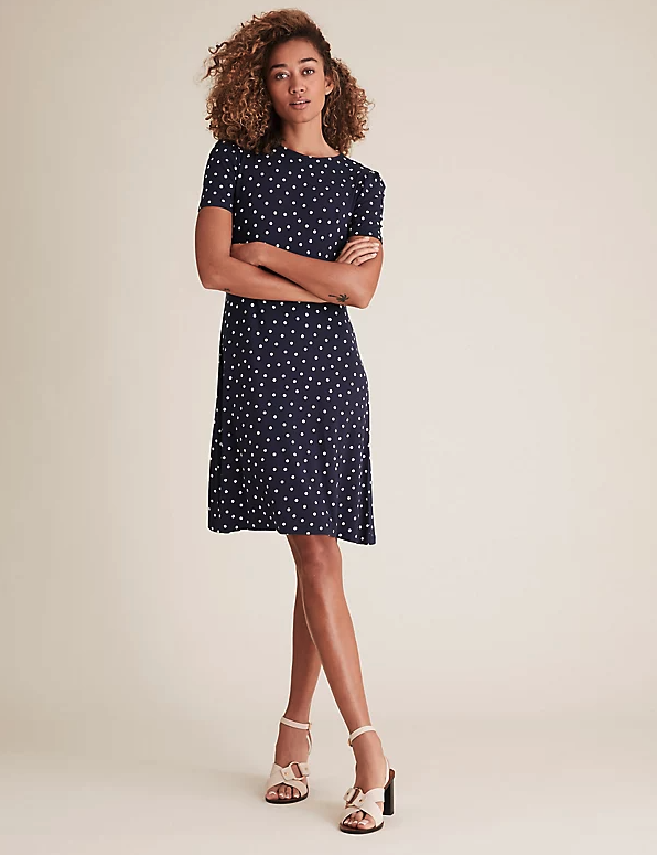 Marks & Spencer Jersey Spot Print Knee Length Swing Dress. Image via Marks & Spencer.