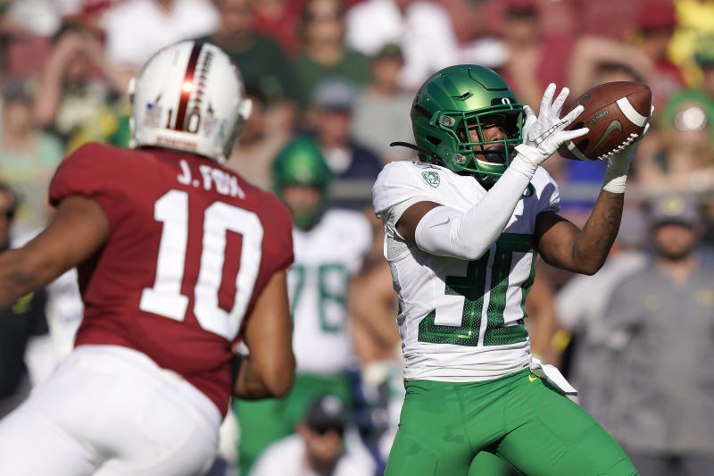 Oregon wide receiver Jaylon Redd (30) catches a pass in front of Stanford linebacker Jordan Fox (10) during the first half of an NCAA college football game on Saturday, Sept. 21, 2019, in Stanford, Calif. (AP Photo/Tony Avelar)