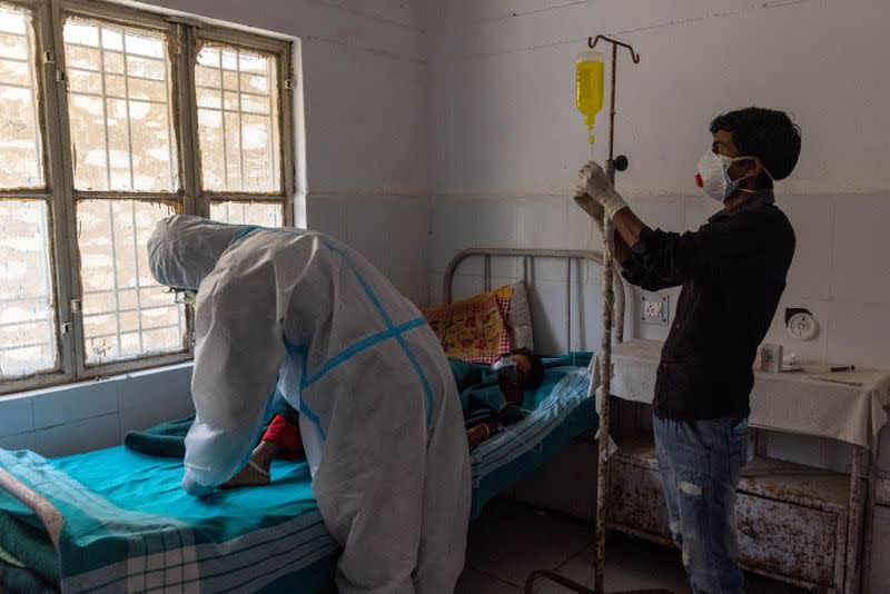 The Wider Image: Death in the Himalayas: Poverty, fear, stretched resources propel India's COVID crisis