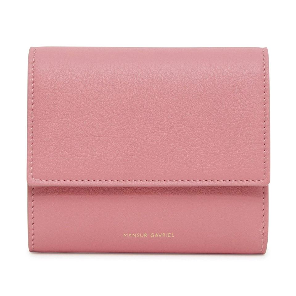 """Mansur Gavriel's buttery-soft leather handbags and accessories are always, in a word, pretty—and this is no exception. Make a statement with this bubblegum-pink trifold wallet. $325, Mansur Gavriel. <a href=""""https://www.mansurgavriel.com/products/trifold-wallet-spiga"""" rel=""""nofollow noopener"""" target=""""_blank"""" data-ylk=""""slk:Get it now!"""" class=""""link rapid-noclick-resp"""">Get it now!</a>"""