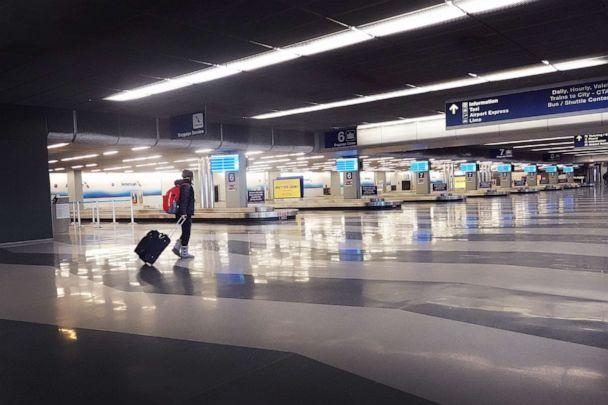 PHOTO: A traveler arrives at a nearly-deserted O'Hare International Airport on April 2, 2020, in Chicago. (Scott Olson/Getty Images)
