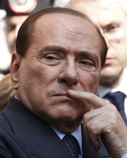 "FILE -- In this file photo taken on May 11, 2012 former Italian premier Silvio Berlusconi attends a ceremony in Milan. Berlusconi says he won't run for a fourth term as premier in spring elections. Berlusconi has until now been coy about his intentions. But the three-time former premier posted a statement on his movement's website Wednesday, Oct. 24, 2012, under the headline: ""I won't run for premier."" He recommended that his People of Liberty movement hold primaries on Dec. 16 to decide a candidate for premier. (AP Photo/Luca Bruno)"