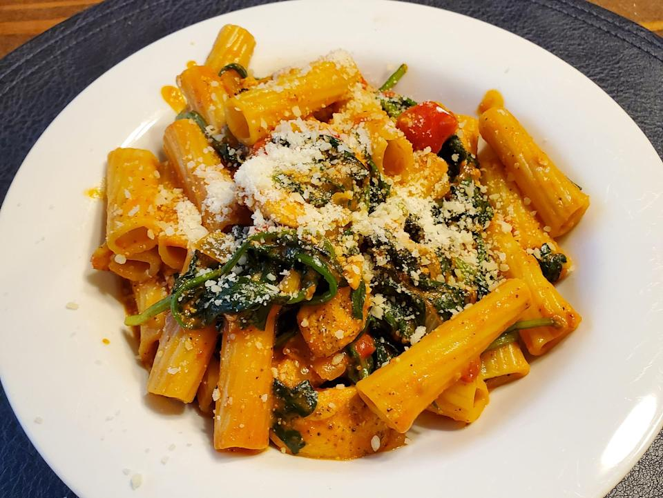 bowl of pasta with veggies and cheese