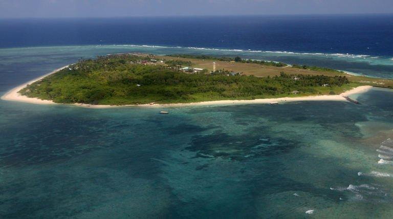 This file photo taken on July 20, 2011 shows an aerial view of Thitu island, part of the disputed Spratly Islands, in the South China Sea. A handful of marines living on a World War II-era ship that is grounded on a remote, tiny reef is the Philippines' last line of defence against China's efforts to control most of the South China Sea