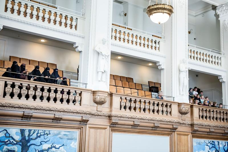 Women in niqabs observe the Danish Parliament as it bans face veils in public in a vote Thursday at Christiansborg Palace in Copenhagen.