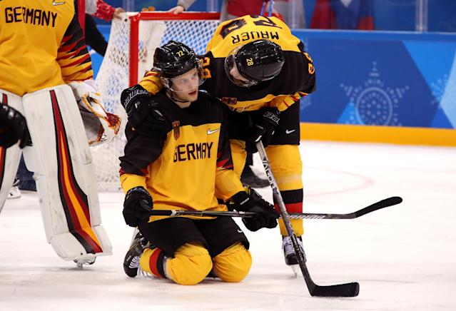 <p>Silver medal winners Dominik Kahun #72 and Frank Mauer #28 of Germany react after being defeated by Olympic Athletes from Russia 4-3 in overtime during the Men's Gold Medal Game on day sixteen of the PyeongChang 2018 Winter Olympic Games at Gangneung Hockey Centre on February 25, 2018 in Gangneung, South Korea. (Photo by Bruce Bennett/Getty Images) </p>
