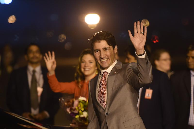 <p>Prime Minister Justin Trudeau and his wife were greeted by Indian officials and media waiting on the ground. Several Liberal ministers met up with the Canadian leader for his Asian trip. Photo from Getty Images. </p>