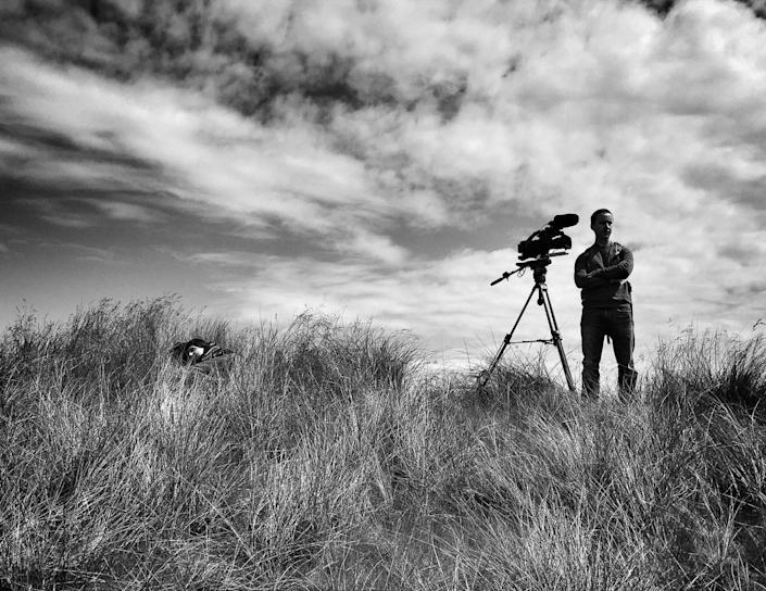 <p>A reporter sleeps on a dune while awaiting the arrival of Donald Trump at his golf course on June 25 outside Aberdeen, Scotland. (Photo: Holly Bailey/Yahoo News) </p>
