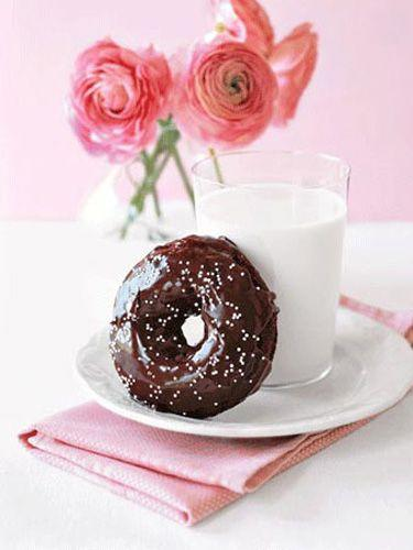 """<p>A double-chocolate doughnut adorned with a flurry of white sprinkles and paired with milk is a true Mother's Day delight. Deliver it to her on tray decked out with a bud vase holding fresh spring blossoms.</p><p><strong><a href=""""https://www.countryliving.com/food-drinks/recipes/a1166/double-chocolate-doughnuts-3273/"""" rel=""""nofollow noopener"""" target=""""_blank"""" data-ylk=""""slk:Get the recipe"""" class=""""link rapid-noclick-resp"""">Get the recipe</a>.</strong><br></p>"""