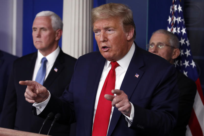 President Donald Trump speaks about the coronavirus in the James Brady Briefing Room, Tuesday, March 24, 2020, in Washington, as Vice President Mike Pence and Dr. Anthony Fauci, director of the National Institute of Allergy and Infectious Diseases, listen. (AP Photo/Alex Brandon)