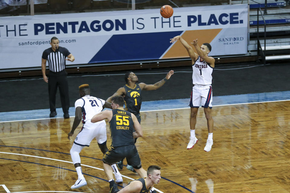 Gonzaga guard Jalen Suggs (1) shoot a 3-pointer during the first half of an NCAA college basketball game against Iowa, Saturday, Dec. 19, 2020 in SIoux Falls, S.D. (AP Photo/Josh Jurgens)
