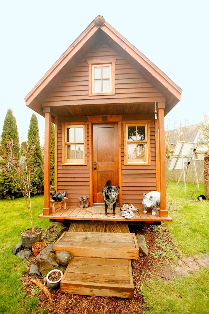 """<p>This is the Olympia, Washington home of tiny house pioneer Dee Williams, author of <em><a href=""""https://www.amazon.com/The-Big-Tiny-Built-It-Myself-Memoir/dp/0399166173?tag=syn-yahoo-20&ascsubtag=%5Bartid%7C10072.g.35047961%5Bsrc%7Cyahoo-us"""" rel=""""nofollow noopener"""" target=""""_blank"""" data-ylk=""""slk:The Big Tiny"""" class=""""link rapid-noclick-resp"""">The Big Tiny</a>, </em>a memoir that details her decision to downsize to an 84-square-foot house that she built from the ground up after a near-death experience. Constructed atop a metal truck trailer, the super-small pine-and-cedar bungalow houses a kitchen counter with a propane one-burner, a sleeping loft, solar-powered lights, a composting toilet, and a sink (but no running water). To help others realize their tiny house dreams, Dee also founded <a href=""""http://padtinyhouses.com/"""" rel=""""nofollow noopener"""" target=""""_blank"""" data-ylk=""""slk:Portland Alternative Dwellings"""" class=""""link rapid-noclick-resp"""">Portland Alternative Dwellings</a>, a tiny house education, resource, and consulting company.<br></p><p><a class=""""link rapid-noclick-resp"""" href=""""https://www.amazon.com/The-Big-Tiny-Built-It-Myself-Memoir/dp/0399166173?tag=syn-yahoo-20&ascsubtag=%5Bartid%7C10072.g.35047961%5Bsrc%7Cyahoo-us"""" rel=""""nofollow noopener"""" target=""""_blank"""" data-ylk=""""slk:SHOP NOW"""">SHOP NOW</a> <a class=""""link rapid-noclick-resp"""" href=""""http://www.nytimes.com/2014/04/17/garden/square-feet-84-possessions-305.html?_r=1"""" rel=""""nofollow noopener"""" target=""""_blank"""" data-ylk=""""slk:SEE INSIDE"""">SEE INSIDE</a></p>"""