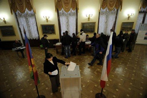 A woman casts her ballot in a polling station in the Black Sea resort of Sochi today