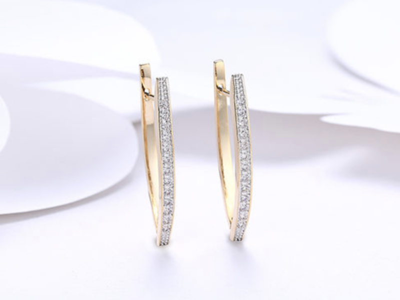 Swarovski Crystal Micro-Pav'e Curved Huggie Earrings In 18K Plated Gold. (Photo: Yahoo Lifestyle Shop)