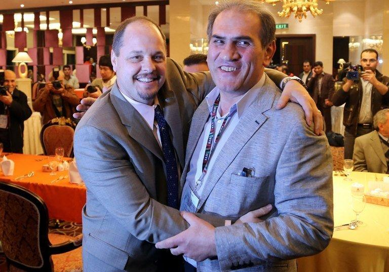 USA Wrestling's Executive Director Rich Bender (L) poses for a picture with the head of Iran's wrestling federation Hojatollah Khatib during a meeting held on the sidelines of the wrestling World Cup tournament in Tehran on February 20, 2013