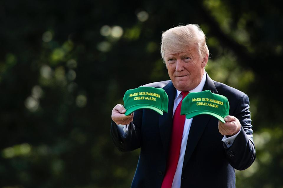 President Donald J. Trump, carrying 'MAKE OUR FARMERS GREAT AGAIN!' hats, walks from the Oval Office to board the Marine One helicopter as he departs from the South Lawn of the White House on Thursday, Aug 30, 2018 in Washington, DC. (Photo: Jabin Botsford/The Washington Post via Getty Images)