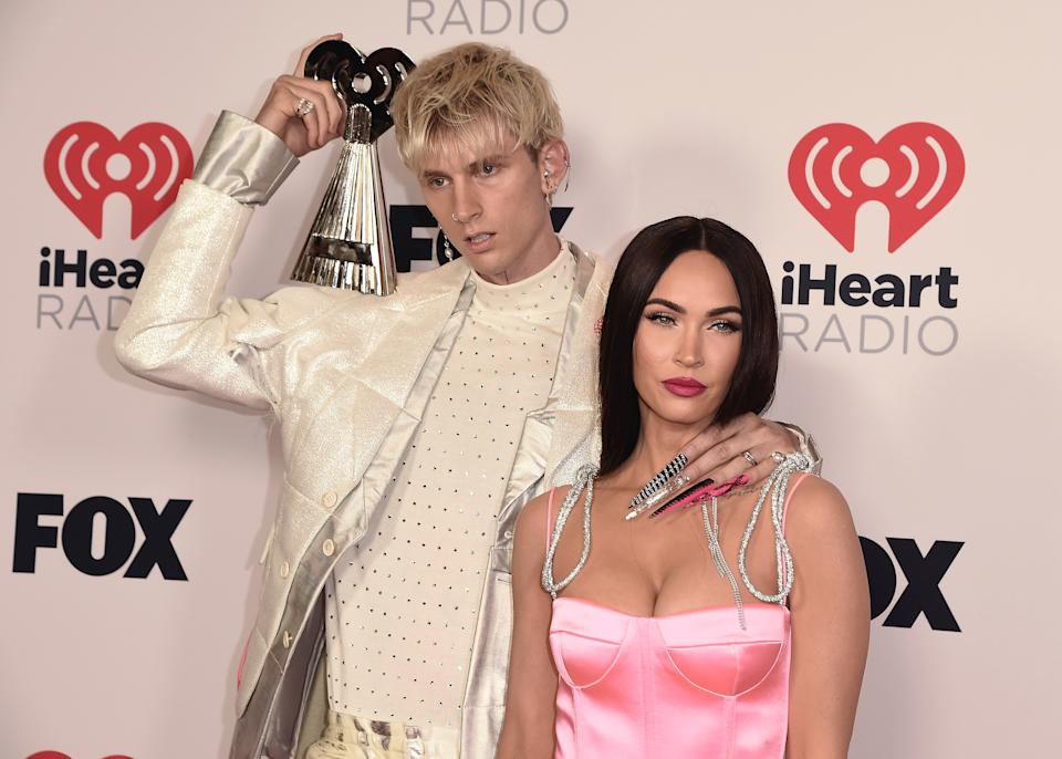 HOLLYWOOD, CA - MAY 27: Machine Gun Kelly and Megan Fox with the award for Alternative Rock Album of the Year at the 2021 �iHeartRadio Music Awards� airing live from The Dolby Theatre in Los Angeles, Thursday, May 27 (8:00-10:00 PM ET live / PT tape-delayed) on FOX. CR: Scott Kirkland/FOX/PictureGroup/Sipa USA � 2021 FOX MEDIA, LLC. (Photo by Scott Kirkland/FOX/PictureGroup/Sipa USA)