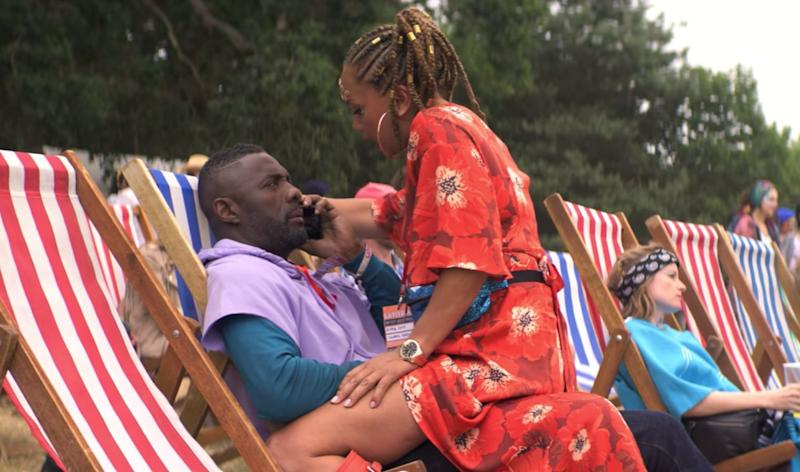 Angela Griffin's Astrid straddles Idris Elba's Charlie in the Netflix comedy show. (Netflix)