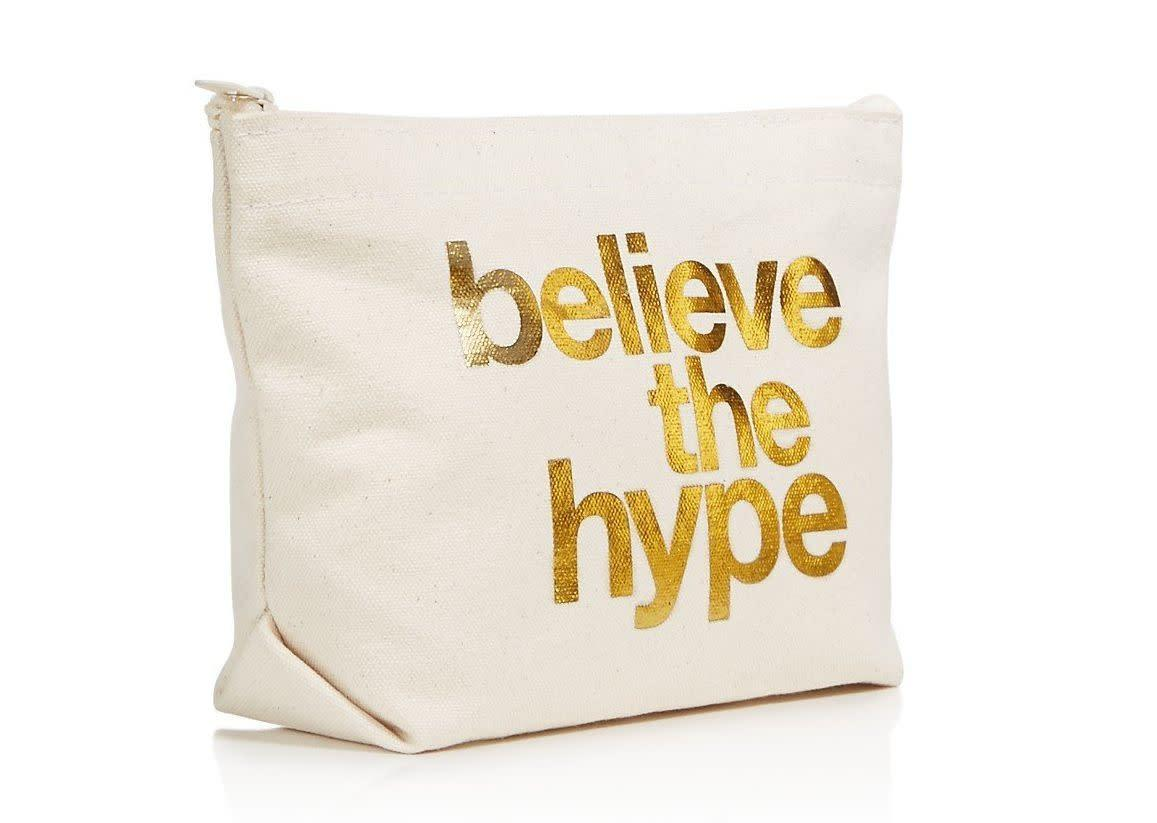 "<i>Buy it from <a href=""https://www.bloomingdales.com/shop/product/dogeared-believe-the-hype-cosmetics-case-100-exclusive?ID=2724265&amp;CategoryID=16958#fn=ppp%3Dundefined%26sp%3D1%26rId%3D82%26spc%3D45%26cm_kws%3Dmakeup%20bag%26spp%3D15%26pn%3D1%7C1%7C15%7C45%26rsid%3Dundefined"" rel=""nofollow noopener"" target=""_blank"" data-ylk=""slk:Bloomingdale's"" class=""link rapid-noclick-resp"">Bloomingdale's</a>&nbsp;for $28.</i>"