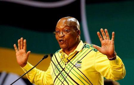 FILE PHOTO: President of South Africa Jacob Zuma gestures to his supporters at the 54th National Conference of the ruling ANC at the Nasrec Expo Centre in Johannesburg