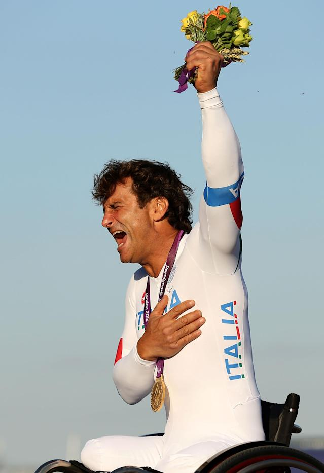 LONGFIELD, ENGLAND - SEPTEMBER 05: Alessandro Zanardi of Italy celebrates on the podium with his Gold medal after winning the Men's Individual H4 Time Trialon day 7 of the London 2012 Paralympic Games at Brands Hatch on September 5, 2012 in Longfield, England. (Photo by Clive Rose/Getty Images)