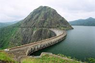 <p>The Idukki Dam, located in Kerala, India, is a 168.91 m (554 ft) tall arch dam. The dam stands between the two mountains - Kuravanmala (839) m and Kurathimala (925)m. It was constructed and is owned by the Kerala State Electricity Board. It supports a 780 MW hydroelectric power station.</p> <p>It is built on the Periyar River, in the ravine between the Kuravan and Kurathi Hills in Kerala, India. At 167.68 metres, it is one of the highest arch dams in Asia and third tallest dam in India.</p> <p>Photo by http://www.kseb.in/ [CC-BY-SA-2.5-in (http://creativecommons.org/licenses/by-sa/2.5/in/deed.en)], via Wikimedia Commons</p>