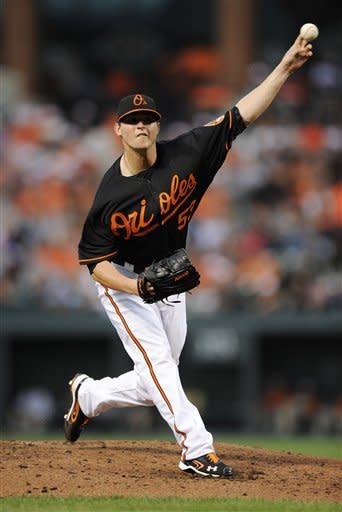 Baltimore Orioles starter Zach Britton delivers a pitch to an Oakland Athletics batter during the third inning of a baseball game, Friday, July 27, 2012, in Baltimore. (AP Photo/Nick Wass)