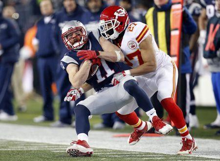 Jan 16, 2016; Foxborough, MA, USA; New England Patriots wide receiver Julian Edelman (11) is tackles by Kansas City Chiefs defensive back Tyvon Branch (27) during the first quarter in the AFC Divisional round playoff game at Gillette Stadium. Mandatory Credit: Greg M. Cooper-USA TODAY Sports / Reuters Picture Supplied by Action Images