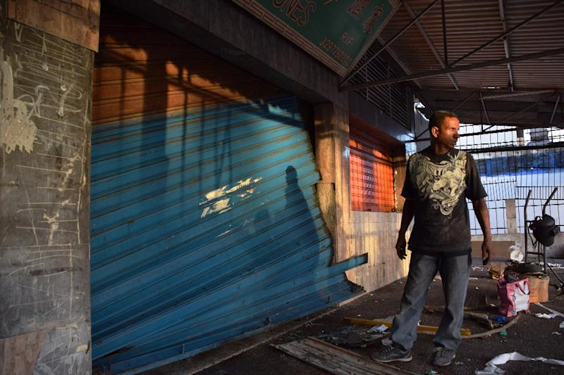 A store is closed in Cumana, Venezuela, after looting in the city (AFP Photo/Manuel Trujillo)