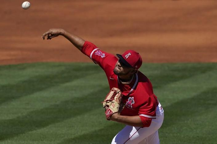 Los Angeles Angels starting pitcher Jaime Barria throws against the Oakland Athletics.
