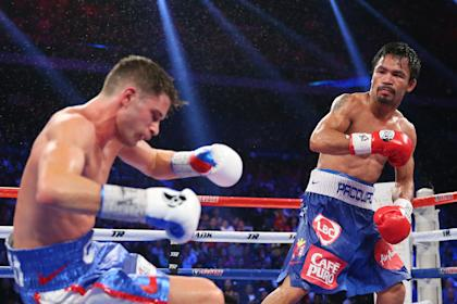 Manny Pacquiao knocks down Chris Algieri during their WBC title fight. (Getty)
