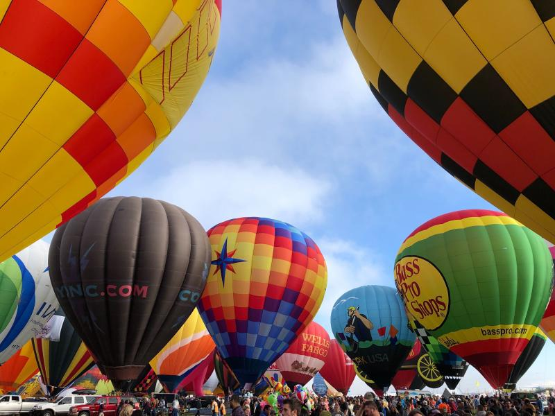 Hot air balloons are inflated during the annual Albuquerque International Balloon Fiesta in Albuquerque, N.M., on Saturday, Oct. 5, 2019. Organizers are expecting tens of thousands of spectators for opening weekend and exponentially more over the course of the nine-day event. (AP Photo/Susan Montoya Bryan)