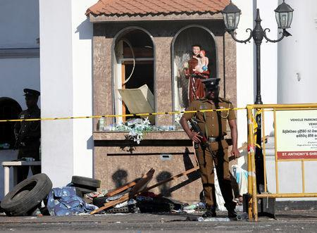 Police officers guard St Anthony's Shrine in Colombo, after bomb blasts ripped through churches and luxury hotels on Easter, in Sri Lanka April 22, 2019. REUTERS/Athit Perawongmetha
