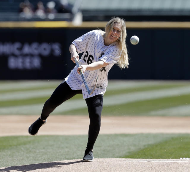 United States Women's Olympic Hockey player Kendall Coyne makes the ceremonial first pitch with a hockey stick before a game between the Detroit Tigers and the Chicago White Sox. (AP Photo)