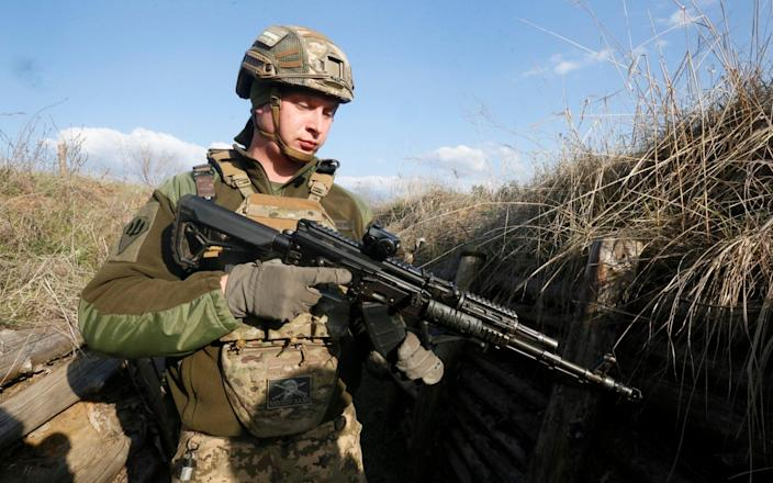 A Ukrainian soldier is seen at fighting positions on the line of separation from pro-Russian rebels near Luhansk - AP