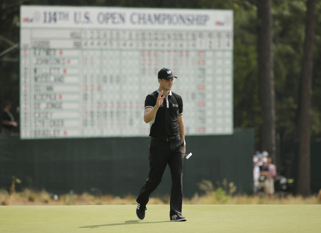 Martin Kaymer, of Germany, waves on the 18th green during the second round of the U.S. Open golf tournament in Pinehurst, N.C., Friday, June 13, 2014. (AP Photo/Chuck Burton)