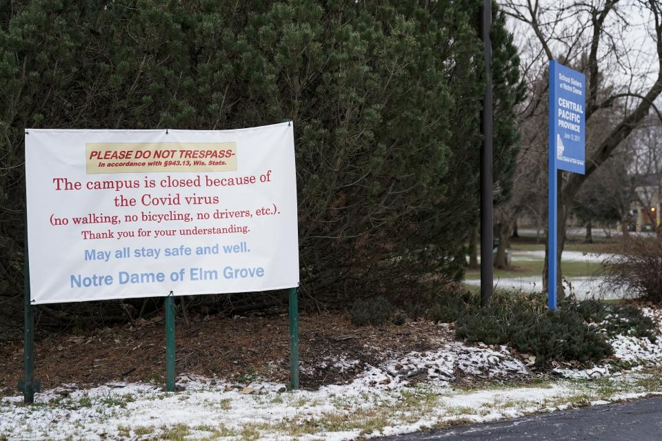 A do not trespass sign is displayed outside the School Sisters of Notre Dame Central Pacific Province, Thursday, Dec. 17, 2020, in Elm Grove, Wis. Eight nuns living in the suburban Milwaukee covent have died in the last week from COVID-19, according to the congregation. (AP Photo/Morry Gash)