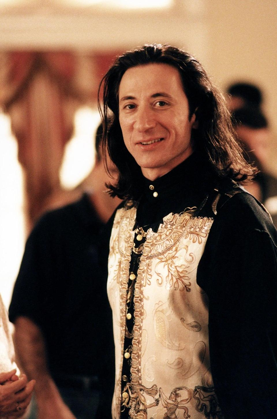 """<p>As an Italian immigrant, Furio's personal style differs from his New Jersey-born family. While his mob counterparts favor a more mainstream, American wardrobe - bowling shirts, neutral color palettes, gold jewelry galore - Furio opts for Versace silk blouses and flowy Fabio-esque hair, influenced by his Italian roots. His distinct, Euro-flair look, paired with his thick accent, makes Furio stand out among the group, and later, catch the eyes of the boss's wife. Now we're seeing a resurgence of luxury Italian brands come to the limelight. While on vacation in Italy, Kylie Jenner wore <a href=""""https://www.popsugar.com/fashion/Kylie-Jenner-Versace-Outfit-Gold-Bottega-Veneta-Sandals-46480348"""" class=""""link rapid-noclick-resp"""" rel=""""nofollow noopener"""" target=""""_blank"""" data-ylk=""""slk:Versace head-to-toe"""">Versace head-to-toe</a> and <a class=""""link rapid-noclick-resp"""" href=""""https://www.popsugar.com/Taylor-Swift"""" rel=""""nofollow noopener"""" target=""""_blank"""" data-ylk=""""slk:Taylor Swift"""">Taylor Swift</a> stepped onto the Teen Choice Awards blue carpet in a <a href=""""https://www.popsugar.com/fashion/Taylor-Swift-Outfit-Teen-Choice-Awards-2019-46487855"""" class=""""link rapid-noclick-resp"""" rel=""""nofollow noopener"""" target=""""_blank"""" data-ylk=""""slk:three-piece Versace suit"""">three-piece Versace suit</a>.</p>"""