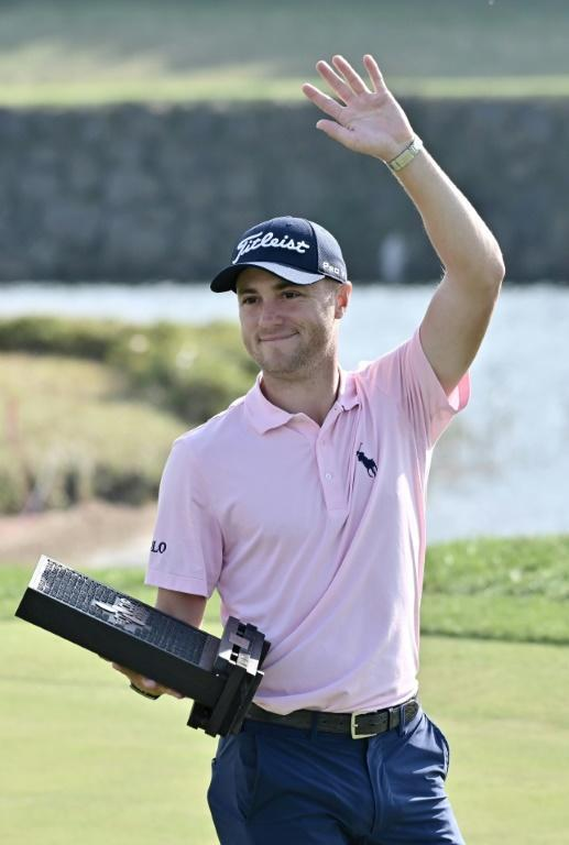 Justin Thomas of the US celebrates winning the CJ Cup golf tournament at Nine Bridges golf club in Jeju Island on October 20, 2019. (AFP Photo/Jung Yeon-je)