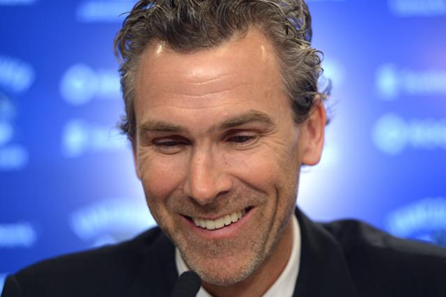 Former Vancouver Canucks captain Trevor Linden laughs during a press conference in Vancouver on Wednesday, April 9, 2014. Linden has been hired as Vancouver's president of hockey operations. (AP Photo/The Canadian Press, Jonathan Hayward)